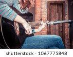 girl playing guitar in... | Shutterstock . vector #1067775848
