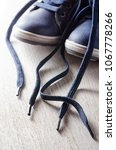 kid's boots with shoelaces on... | Shutterstock . vector #1067778266