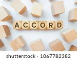 Small photo of ACCORD word on wooden cubes