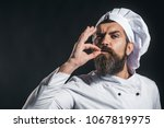 serious bearded chef  cook or... | Shutterstock . vector #1067819975