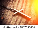 silver cross on a wood... | Shutterstock . vector #1067850836