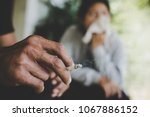 image of cigarette is in the... | Shutterstock . vector #1067886152