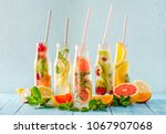variety of fruit infused detox... | Shutterstock . vector #1067907068