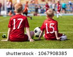 coaching kids soccer. young... | Shutterstock . vector #1067908385