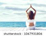 attractive girl in white sporty ... | Shutterstock . vector #1067931806