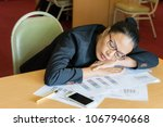 tired businesswoman exhausted... | Shutterstock . vector #1067940668