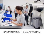 female engineer quality... | Shutterstock . vector #1067940842