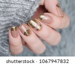 beige nude manicure with gold... | Shutterstock . vector #1067947832