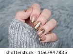 beige nude manicure with gold... | Shutterstock . vector #1067947835
