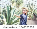 a young pretty woman pointing... | Shutterstock . vector #1067959298