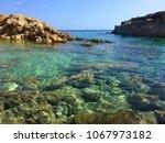 seascape at cala zaffiro sicily ... | Shutterstock . vector #1067973182