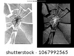 smashed glass isolated on black ... | Shutterstock . vector #1067992565