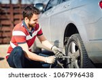smiling man and mechanic... | Shutterstock . vector #1067996438