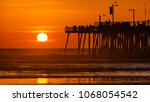 Sunset Silhoutte Of The Pier...