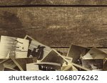 old photos on the wooden table | Shutterstock . vector #1068076262