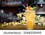 yellow summer cocktail... | Shutterstock . vector #1068100445