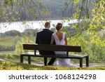 just married young couple in... | Shutterstock . vector #1068124298