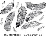 set of feathers hand drawn... | Shutterstock . vector #1068140438