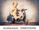 teddy bear sitting on old black ... | Shutterstock . vector #1068152048