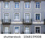 blue facade of the old building ... | Shutterstock . vector #1068159008
