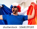 french fan celebrating at home. ... | Shutterstock . vector #1068159185