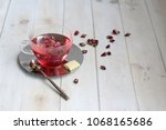 pink peony hot tea with white... | Shutterstock . vector #1068165686