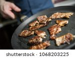 the process of cooking. man... | Shutterstock . vector #1068203225