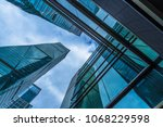 low angle view of skyscrapers... | Shutterstock . vector #1068229598