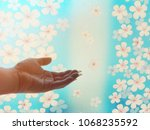 Small photo of The hands protrude forward to touch the natural beauty which symbolizes life and the environment.