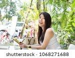 a beautiful tourist woman has... | Shutterstock . vector #1068271688