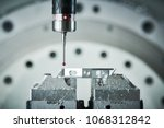 Small photo of Quality control on milling CNC machine. Precision probe sensor at industrial metalworking