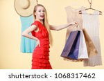 woman in clothes shop store... | Shutterstock . vector #1068317462