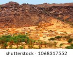 village of mhaireth and oasis ... | Shutterstock . vector #1068317552