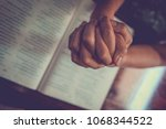 close up prayer's hand pray in... | Shutterstock . vector #1068344522