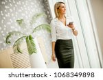young businesswoman with mobile ... | Shutterstock . vector #1068349898