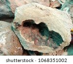 cavity on rock background  | Shutterstock . vector #1068351002