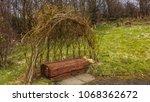 wooden bench seat under an... | Shutterstock . vector #1068362672