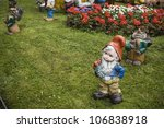 Garden Gnomes On A Lawn.