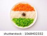tricolor tiranga rice for... | Shutterstock . vector #1068402332