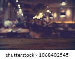 wood table on blur of cafe ... | Shutterstock . vector #1068402545