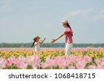 mother and daughter playing in... | Shutterstock . vector #1068418715