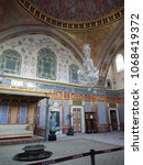 Small photo of TOPKAPI PALACE & HAREM MUSEUM, ISTAMBUL. TURKEY - DECEMBER 6, 2017. The throne room or Imperial Hall was renovated in the rococo style after the Great Harem Fire of 1666.