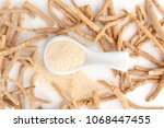 ashwagandha powder in spoon... | Shutterstock . vector #1068447455