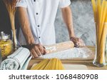 chef use rolling pin with flour ... | Shutterstock . vector #1068480908