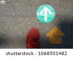 a foot and double arrowhead go... | Shutterstock . vector #1068501482