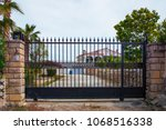 automatic gates for a country... | Shutterstock . vector #1068516338