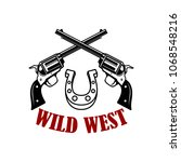 wild west. crossed revolvers on ... | Shutterstock .eps vector #1068548216