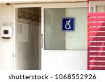 Small photo of Accessible bathroom.Public restroom signs with a disabled access symbol