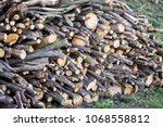 pile of firewood for  fireplace.... | Shutterstock . vector #1068558812