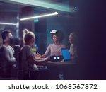 multiethnic business team using ... | Shutterstock . vector #1068567872